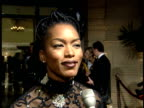 Angela Bassett talks to reporter on the red carpet about choosing her outfits for events why people support the ball and what makes a great party