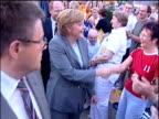 Angela Merkel Chairwoman of Christian Democratic Union shakes hands with people during election campaign walkabout Magdeburg 4 Sep 05