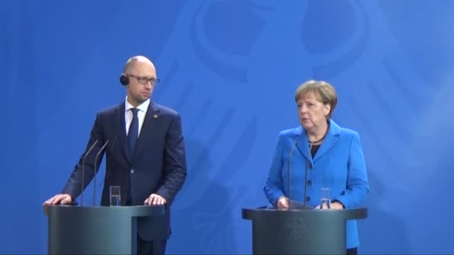 Angela Merkel Germany's chancellor and Arseniy Yatsenyuk Ukraine's prime minister hold a news conference at the Chancellery in Berlin Germany on...