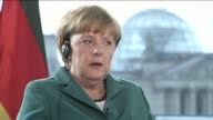 Angela Merkel Germanys chancellor is interviewed by Matt Winkler Bloomberg Television inside the Chancellory building in Berlin Germany on Friday...