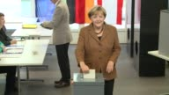 Angela Merkel votes in German legislative elections in a closely watched election that is likely to hand Chancellor Merkel a third term leading...