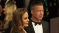Angelina Jolie and Brad Pitt pose for photographers at the BAFTAs 2014