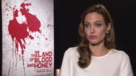 Angelina Jolie on not putting her name to the script her feelings being a Director In The Land of Blood and Honey Interviews 62nd Berlinale...