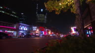 DOWNTOWN HD NIGHT *Angled WS Lower Broadway lined w/ honky tonk bars restaurants Nashville Live Music Venues sign lighted tree FG ATT building BG...