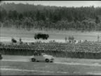 Angled WS US Army Jeeps parked in formation on field WS Convertible car driving past soldiers gathered for inspection WWII training