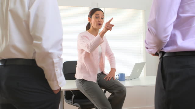 Angry businesswoman in a meeting