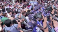 Angry crowds scuffle with police in downtown Yangon in a protest against the Myanmar army's veto on constitutional change blamed for the defeat last...