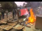 Angry protestors demonstrate around blazing rubbish bin during anti government demonstrations following results of presidential elections Kenya 1...