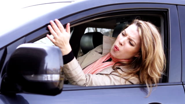 Angry young woman in the car
