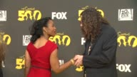 Anika Noni Rose and 'Weird Al' Yankovic at The Simpsons 500th Episode Celebration On The Yellow Carpet in Hollywood CA on 2/13/12