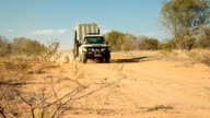 Animal transfer vehicle driving towards camera Rhino poaching is a major threat to the extinction of rhinos living in and around nature reserves in...