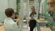 Dog owner to sell her possession sto pay for pet's operation ENGLAND London Paddington INT DollyAnn Osterloh interview as showing reporter items in...
