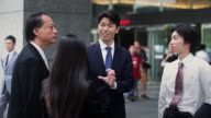 Animated Businessman Talking with Colleagues