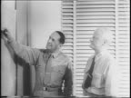 Animated map / B29 Bombers in flight / General Douglas MacArthur stands with Admiral Chester Nimitz looking at map / Navy fleet ships in Pacific /...
