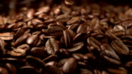 Animation video of falling coffee beans in slow motion