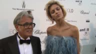 Anja Rubik on the event and her outfit at the amfAR Gala Red Carpet Arrivals 64th Cannes Film Festival at Antibes