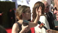 Anna Chlumsky talking to reporter on the red carpet at Nokia Theater LA Live