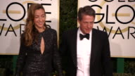 Anna Elisabet Eberstein and Hugh Grant at the 74th Annual Golden Globe Awards Arrivals at The Beverly Hilton Hotel on January 08 2017 in Beverly...