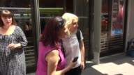 Annaleigh Ashford poses for photos with fans before walking into New 42nd Street Studios for rehearsals of the Broadway revival of 'You Can't Take It...