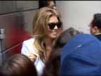 AnnaLynne McCord signs autographs for fans as she departs the CW Upfronts in New York 05/19/11