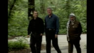 Middle East peace summit 2000 Camp David Bill Clinton walking with Ehud Barak and Yasser Arafat at former Middle East peace summit