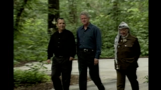 Middle East peace summit 2000 Camp David Bill Clinton walking with Ehud Barak and Yasser Arafat at former Middle East peace summit