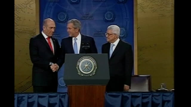 Middle East peace summit USA Maryland Annapolis INT George W Bush shakes hands with Ehud Olmert and Mahmoud Abbas at press conference with VOICEOVER...