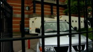 court arrivals ENGLAND Middlesbrough Teesside Crown Court EXT Prison van along to court Car along and Mark Darwin seen through window Mark Darwin...