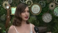 INTERVIEW Anne Hathaway at 'Alice Through The Looking Glass' Event At Roseark at Roseark Gallery on May 12 2016 in Los Angeles California
