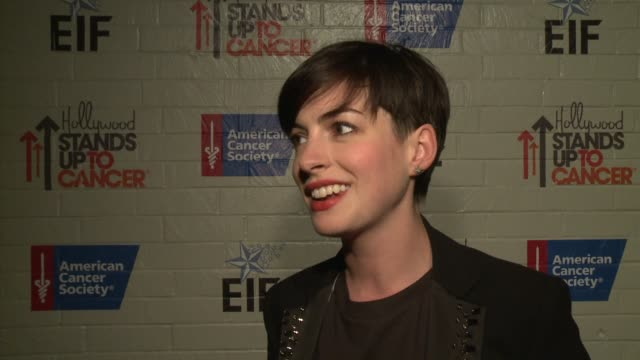 INTERVIEW Anne Hathaway on her personal experience with cancer at Hollywood Stands Up To Cancer on in Los Angeles California