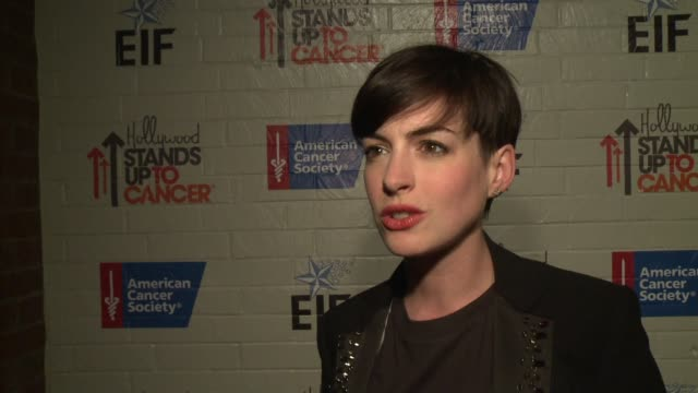 INTERVIEW Anne Hathaway on the need for more cancer research at Hollywood Stands Up To Cancer on in Los Angeles California