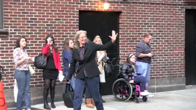 Annie Leibovitz waves to fans as she arrives at the 'Late Show With David Letterman' in New York 11/08/11