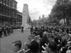 Annual parade of Remembrance at the Cenotaph ENGLAND London Cenotaph EXT CS Tower in Whitehall with British Legion and Union Jack flags flying CU...
