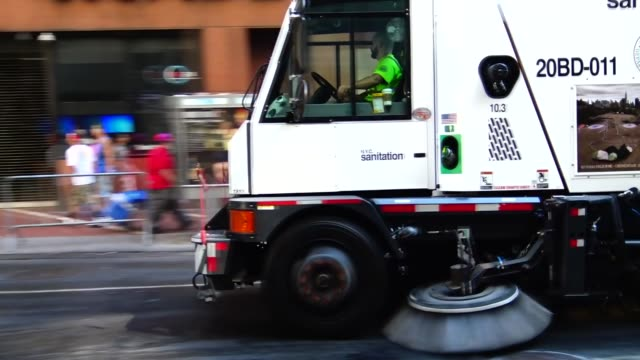 Annual Puerto Rican Day Parade on 5th Avenue Manhattan New York City USA / Department of Sanitation of New York City cleans street after the parade...