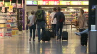 Anonymous passengers from the final flight out of Heathrow's terminal one walk past shops The building at one time Europe's largest shorthaul...