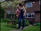 Anorexia twins ENGLAND Birmingham MS Samantha Kendall helped along thru garden by mother Susie BV Ditto as both sit down CS Samantha PULL OUT with...
