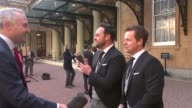 London Buckingham Palace EXT Ant and Dec interview re receiving OBE holding OBE medals up to camera SOT