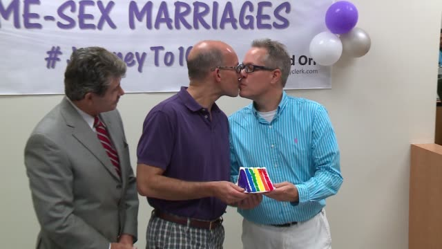 WGN Anthony Aranda and Terry Beauchamp of Edgewater receive Cook County's 10000th samesex marriage license alongside Cook County Clerk David Orr on...