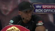 Anthony Joshua SOT / Boxers posing for photocall / Boxers squaring up to each other then shaking hands / Boxers off stage and out of room