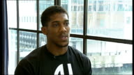 Anthony Joshua makes professional debut Joshua interview SOT Camera operators PAN Joshua and Leo posing for photocall Joshua chatting to man