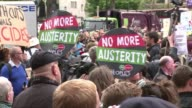Anti austerity protesters march outside 10 Downing Street and past the Houses of Parliament on the day Queen Elizabeth II outlined the newly elected...