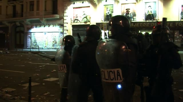 Anti riot police have clashed with anti austerity protesters who threw stones at police in Madrid and set a police van ablaze in Barcelona CLEAN Riot...