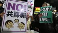 AntiAbe protesters gather with placards and banners during a rally denouncing his government policies and calling on the Japanese prime minister to...