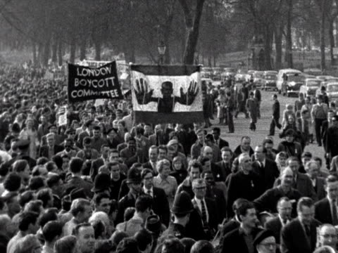 Antiapartheid demonstrators march through London seeking a boycott on products from South Africa