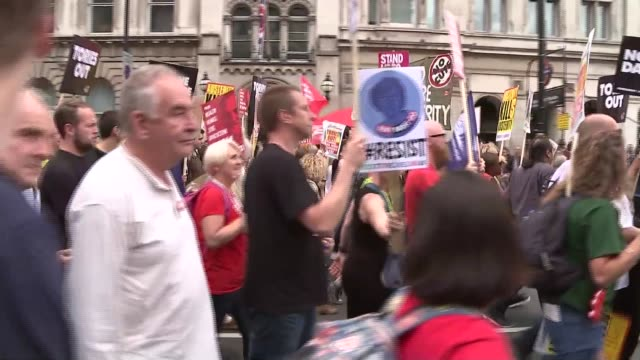 Antiausterity march in London / John McDonnell speech ENGLAND London Westminster EXT Antiausterity protest marchers along Whitehall and into...