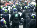 Anticapitalist demonstrators are pushed back by riot police during May Day Protests 01 May 00