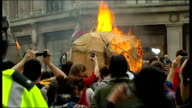 TUC anticuts 'March for the Alternative' hundreds of thousands take part ENGLAND London Oxford Circus EXT Effigy of Trojan Horse being burned in...