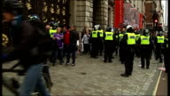 TUC anticuts 'March for the Alternative' Police contain protesters outside Fortnum Mason ENGLAND London EXT Various of riot police officers blocking...