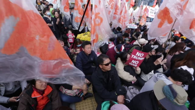 AntiDonald Trump demonstrators protesting during his trip to Seoul South Korea