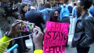 AntiDonald Trump protest outside of the Grand Hyatt Hotel and Grand Central Station / 42nd Street Midtown Manhattan New York City USA / Muslim woman...
